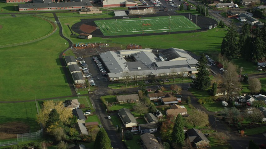 6K stock footage aerial video orbiting Gause Elementary and the Washougal High School football and baseball fields in Washougal, Washington Aerial Stock Footage | AX154_205