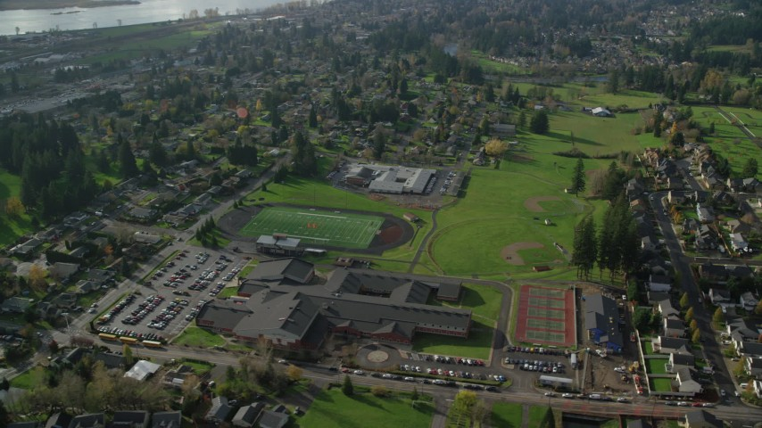 6K stock footage aerial video orbiting Gause Elementary, Washougal High School and sports fields in Washougal, Washington Aerial Stock Footage | AX154_207