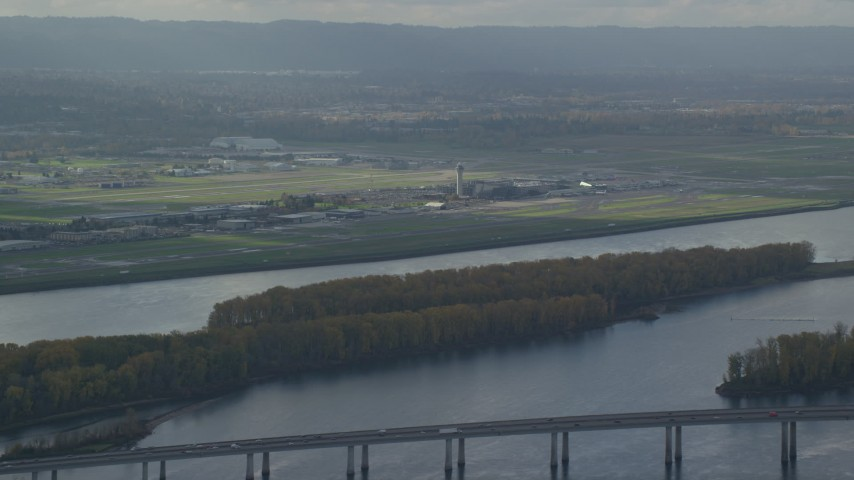 6K stock footage aerial video of Portland International Airport seen from across the Columbia River Aerial Stock Footage | AX154_217