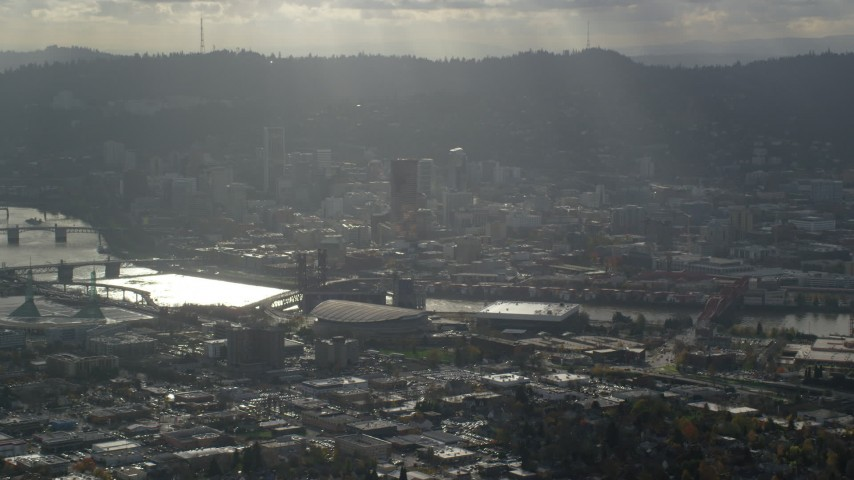 6K stock footage aerial video of godrays coming down on Moda Center, the Willamette River and Downtown Portland, Oregon Aerial Stock Footage | AX154_225