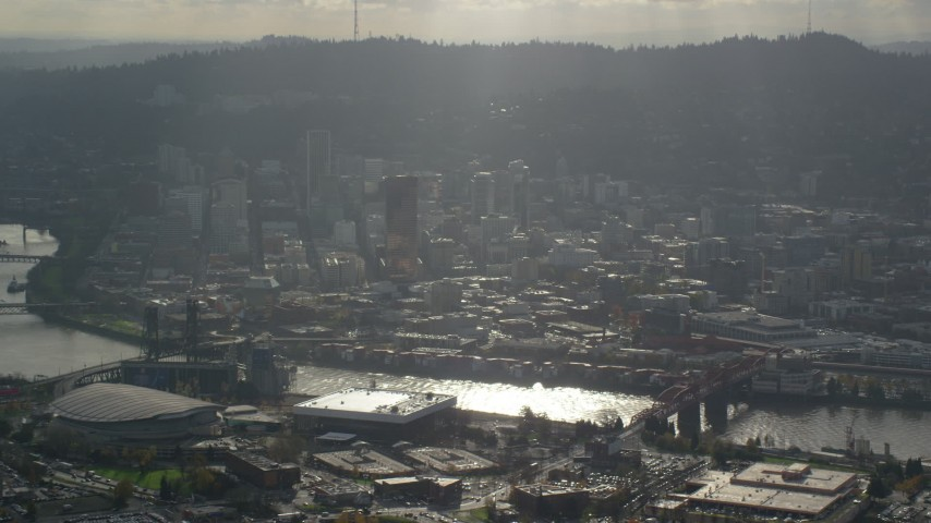 6K stock footage aerial video of godrays shining down on the Willamette River and Downtown Portland, Oregon Aerial Stock Footage | AX154_226