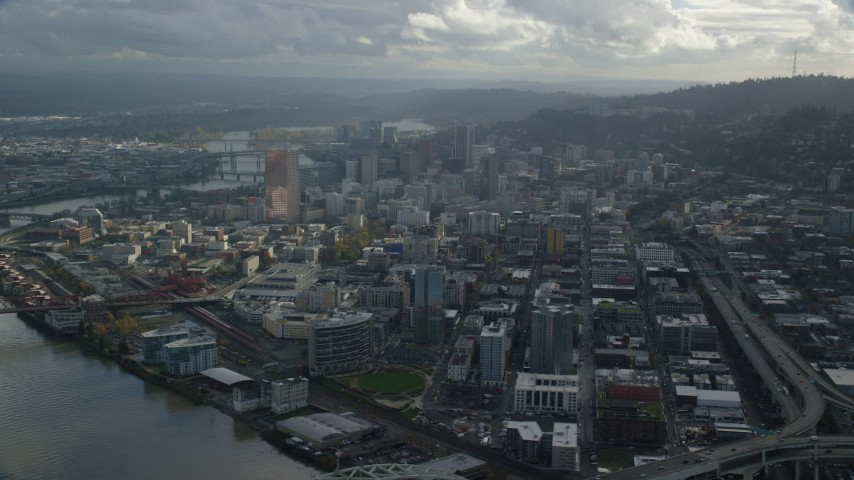 6K stock footage aerial video of skyscrapers and Interstate 405 in Downtown Portland, Oregon Aerial Stock Footage | AX154_228