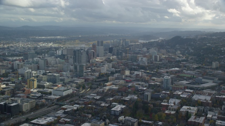 6K stock footage aerial video of skyscrapers seen from Providence Park in Downtown Portland, Oregon Aerial Stock Footage   AX154_229