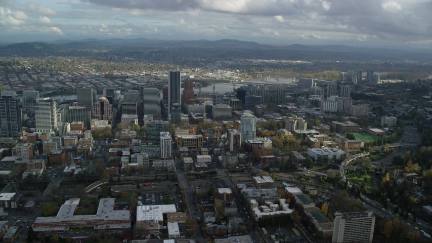 6K stock footage aerial video flying by skyscrapers in Downtown Portland, Oregon while flying over Portland State University Aerial Stock Footage | AX154_231