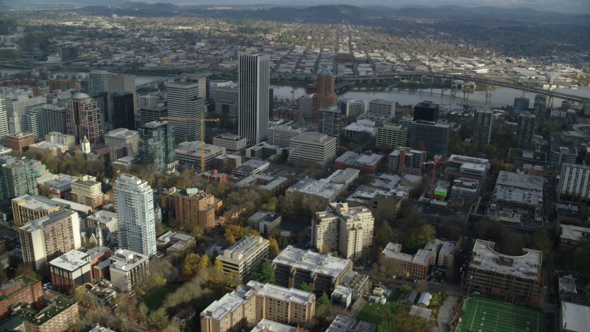 6K stock footage aerial video orbiting PacWest Center, Wells Fargo Center, KOIN Center and skyscrapers in Downtown Portland, Oregon Aerial Stock Footage | AX154_232
