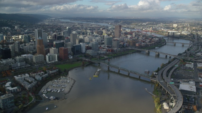 6K aerial video orbiting skyscrapers in Downtown Portland, Oregon, seen from across the Willamette River Aerial Stock Footage | AX154_235