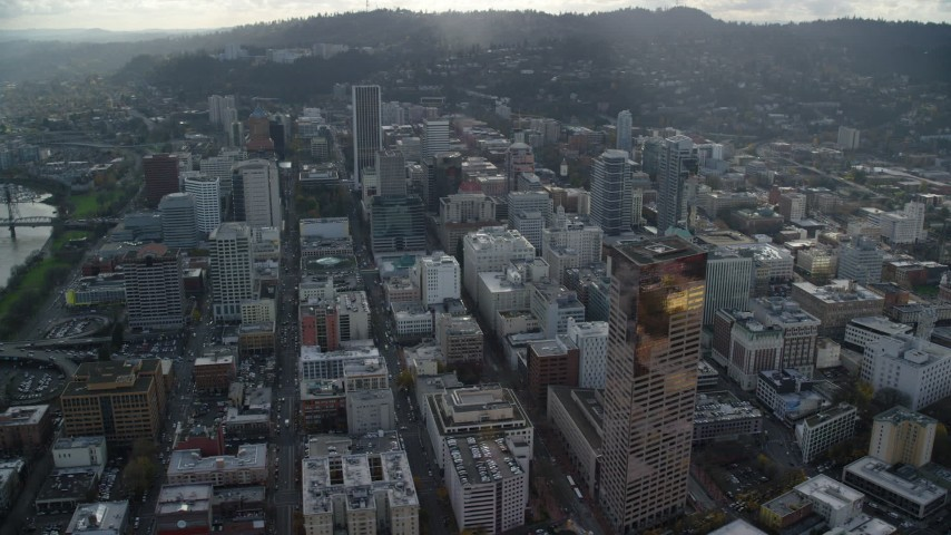 6K stock footage aerial video orbiting skyscrapers and city streets near US Bancorp Tower in Downtown Portland, Oregon Aerial Stock Footage | AX154_238