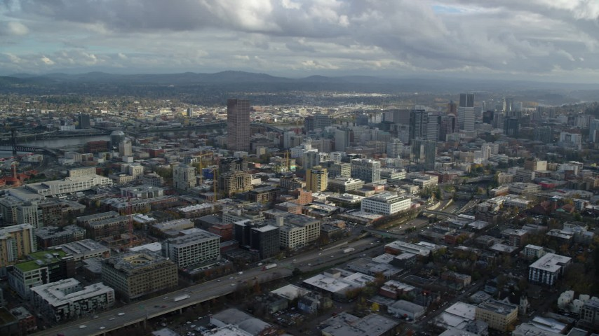 6K stock footage aerial video flying by downtown skyscrapers and Interstate 405 with Willamette River in the background, Downtown Portland, Oregon Aerial Stock Footage | AX154_240