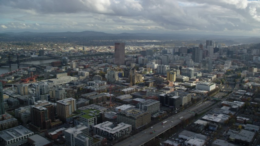 6K stock footage aerial video flying by downtown skyscrapers and Interstate 405 with Willamette River in the background, Downtown Portland, Oregon Aerial Stock Footage   AX154_240