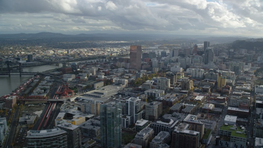 6K stock footage aerial video of Downtown skyscrapers and the Willamette River in Downtown Portland, Oregon Aerial Stock Footage | AX154_241
