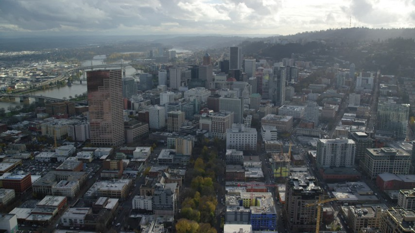 6K stock footage aerial video passing US Bancorp Tower to approach and fly over downtown skyscrapers in Downtown Portland, Oregon Aerial Stock Footage | AX154_243