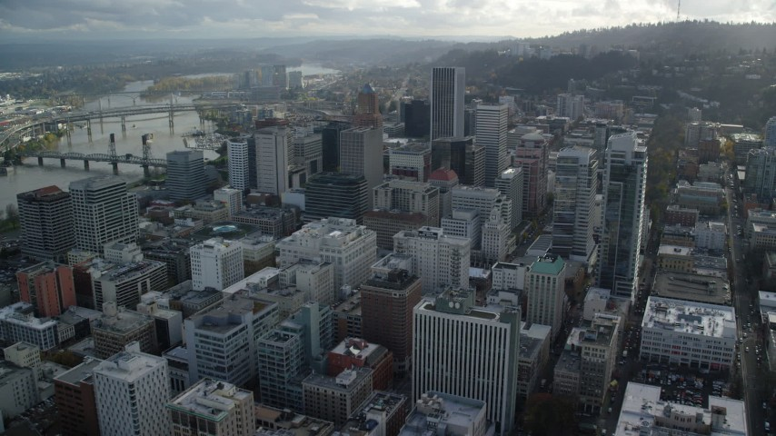 6K stock footage aerial video flying over downtown to approach KOIN Center and Wells Fargo Center in Downtown Portland, Oregon Aerial Stock Footage | AX154_244