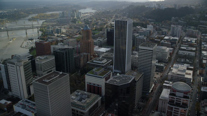 6K stock footage aerial video flying over KOIN Center, Wells Fargo Center, and 200 Market in Downtown Portland, Oregon Aerial Stock Footage | AX154_245