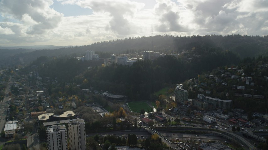6K stock footage aerial video approaching the Oregon Health and Science University complex in the hills over Portland, Oregon Aerial Stock Footage | AX154_246