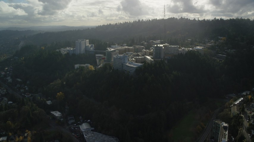 6K stock footage aerial video flying by the Oregon Health and Science University complex in the hills over Portland, Oregon Aerial Stock Footage | AX154_247