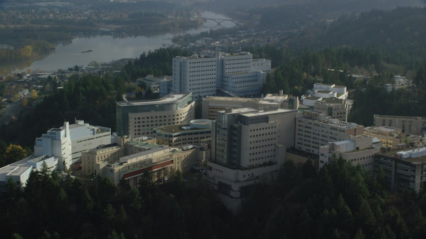 6K stock footage aerial video flying away from the Oregon Health and Science University complex in the hills over Portland, Oregon Aerial Stock Footage | AX154_248