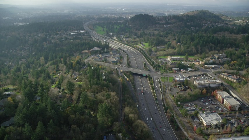 6K stock footage aerial video tilting to bird's eye view of light traffic on Highway 26 through Southwest Portland, Oregon Aerial Stock Footage | AX154_250