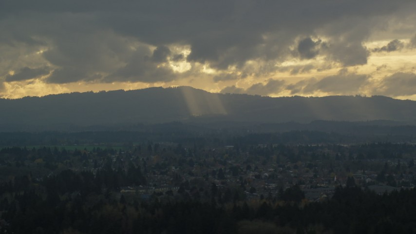 6K aerial video of Cascade Range and godrays shining from clouds seen from suburban neighborhood, Beaverton, Oregon Aerial Stock Footage | AX155_007
