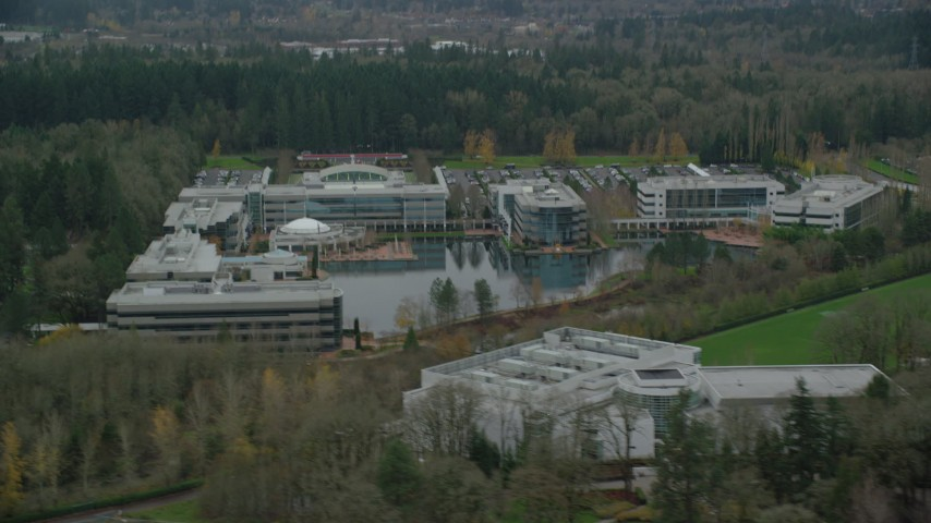 6K stock footage aerial video passing by Nike Headquarters office buildings in Beaverton, Oregon Aerial Stock Footage | AX155_011