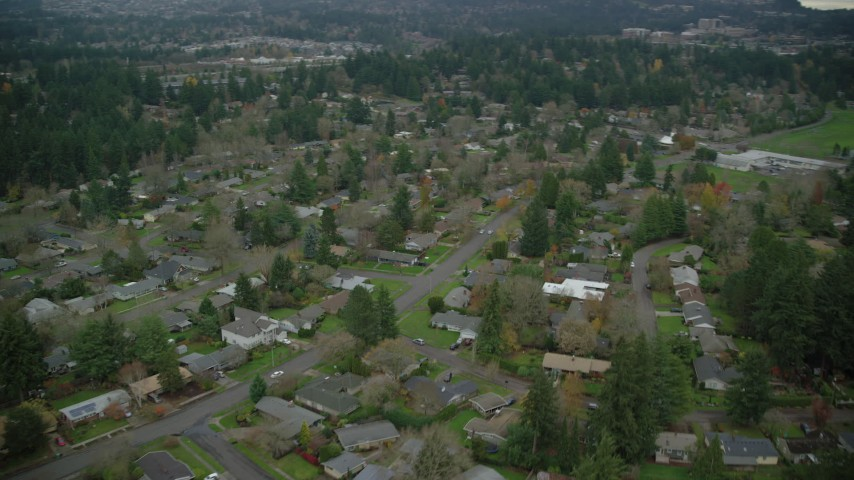 6K stock footage aerial video of homes in a suburban neighborhood in autumn, Beaverton, Oregon Aerial Stock Footage | AX155_012
