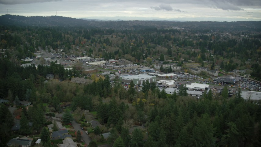 6K stock footage aerial video approaching car dealerships in Southwest Portland, Oregon, and tilt to a bird's eye view of SW Canyon Road Aerial Stock Footage | AX155_014