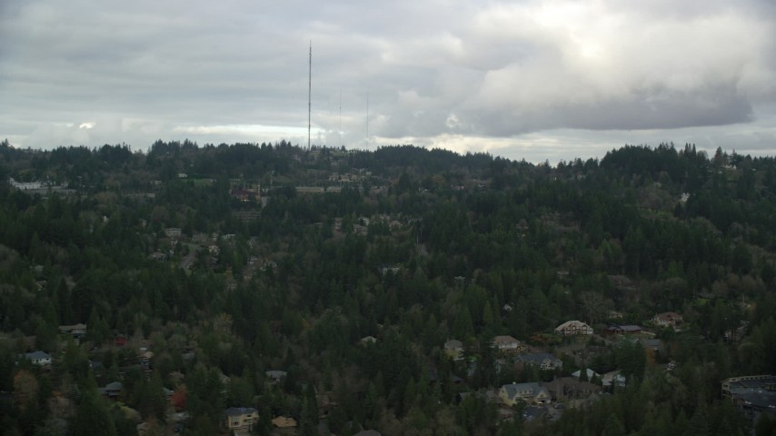 6K stock footage aerial video of Hillside suburban neighborhood in Southwest Portland, Oregon, with radio towers at the top of the hill Aerial Stock Footage | AX155_015