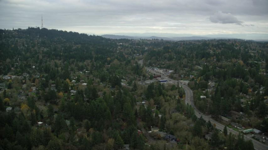 6K stock footage aerial video flying over suburban neighborhood beside SW Beaverton Hillsdale Highway in Southwest Portland, Oregon Aerial Stock Footage | AX155_016
