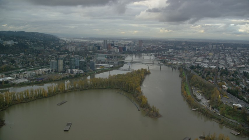 South Waterfront condo high-rises, bridges over the Willamette River, and Downtown Portland, Oregon Aerial Stock Footage | AX155_022