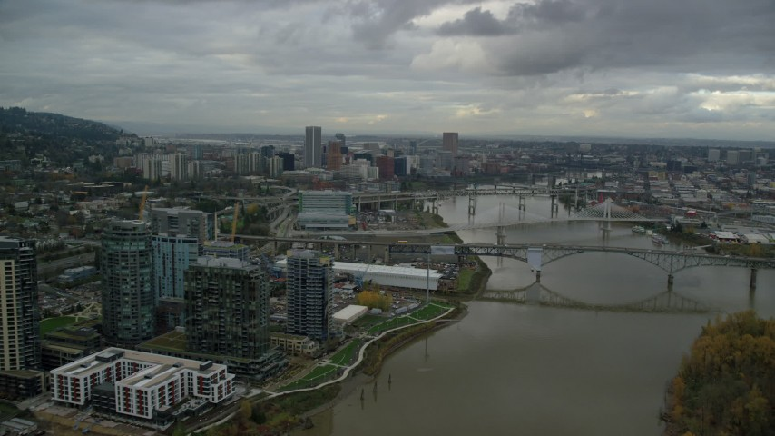 6K stock footage aerial video flying over Ross Island Bridge to approach Downtown Portland, Oregon Aerial Stock Footage | AX155_027