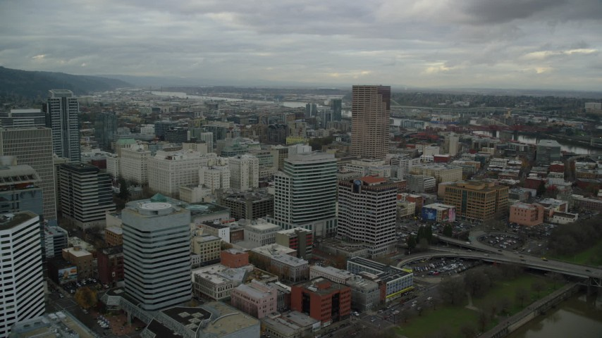 6K stock footage aerial video flying by downtown buildings near US Bancorp Tower in Downtown Portland, Oregon Aerial Stock Footage | AX155_030
