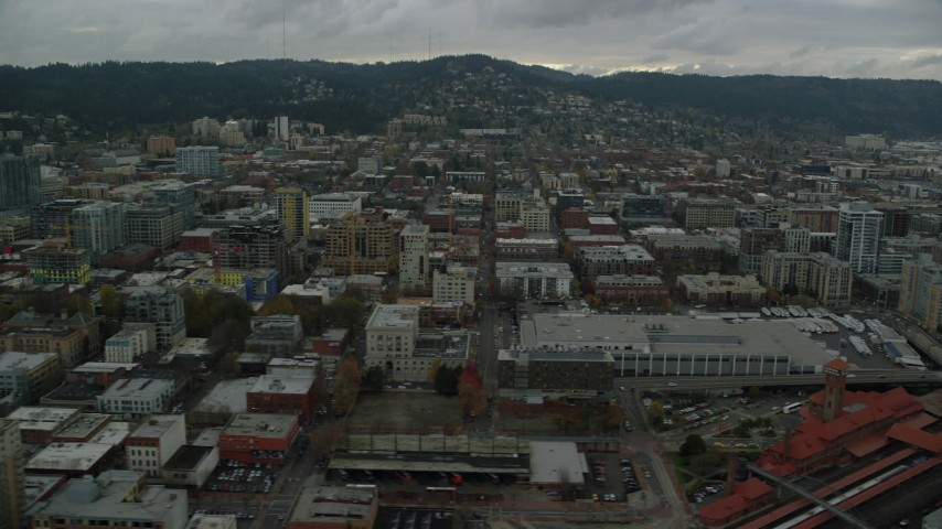 6K stock footage aerial video flying by downtown buildings and Union Station in Downtown Portland, Oregon Aerial Stock Footage | AX155_032