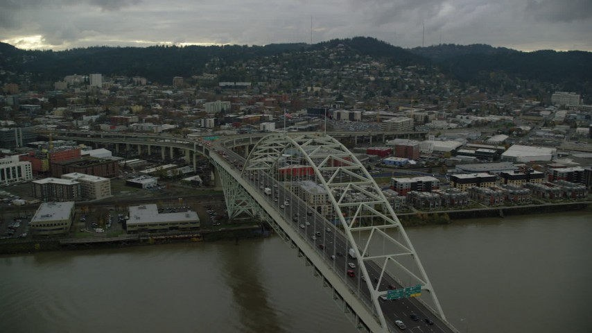6K stock footage aerial video orbiting the Fremont Bridge and reveal skyscrapers in Downtown Portland, Oregon Aerial Stock Footage | AX155_035