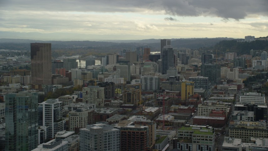 6K stock footage aerial video flying over downtown toward skyscrapers, Downtown Portland, Oregon Aerial Stock Footage   AX155_037