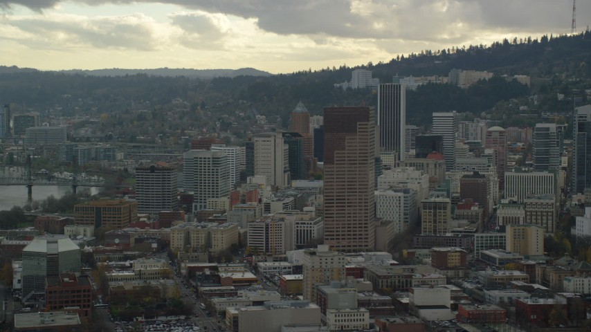 6K stock footage aerial video flying by US Bancorp Tower and skyscrapers in Downtown Portland, Oregon Aerial Stock Footage | AX155_040