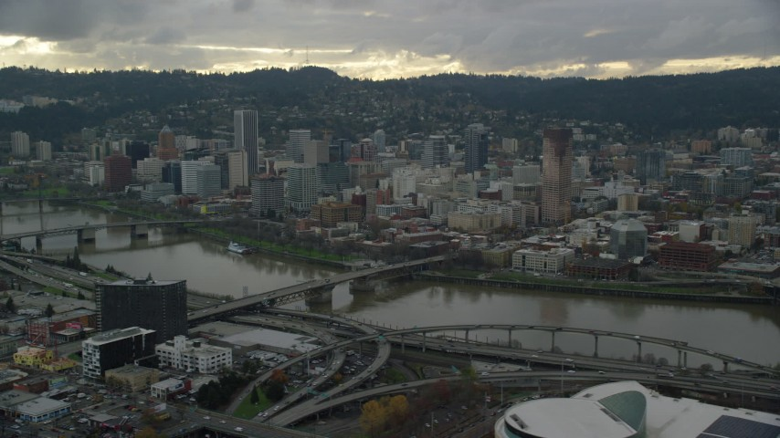 6K stock footage aerial video of Downtown Portland, Oregon, seen across the Willamette River Aerial Stock Footage   AX155_042