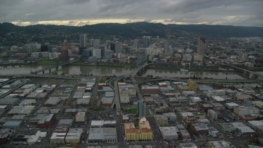 6K stock footage aerial video of bridges over the Willamette River leading to Downtown Portland, Oregon Aerial Stock Footage | AX155_044