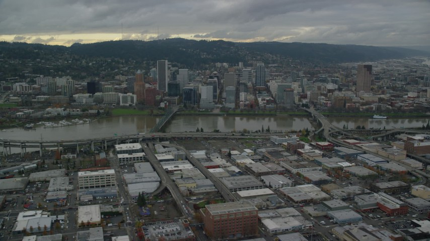 6K stock footage aerial video of bridges spanning the Willamette River leading to Downtown Portland, Oregon Aerial Stock Footage   AX155_045