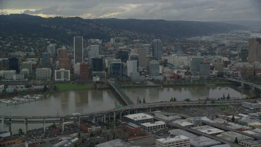 6K stock footage aerial video of Ross Island Bridge, the Hawthorne Bridge, and skyscrapers in Downtown Portland, Oregon Aerial Stock Footage | AX155_046