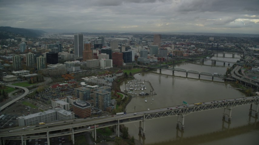 6K stock footage aerial video flying over Marquam Bridge near Riverplace Marina toward Hawthorne Bridge with a view of skyscrapers in Downtown Portland, Oregon Aerial Stock Footage | AX155_050