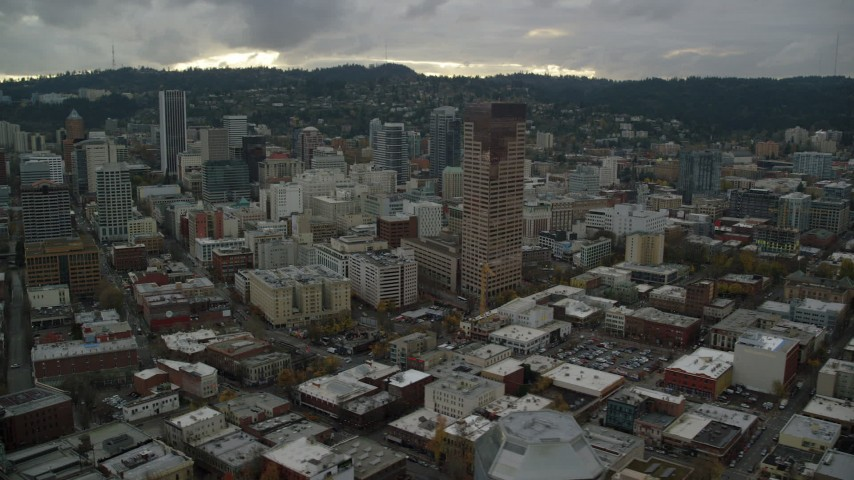 6K stock footage aerial video flying away from skyscrapers, downtown buildings, and US Bancorp Tower, reveal Willamette River in Downtown Portland, Oregon Aerial Stock Footage | AX155_053