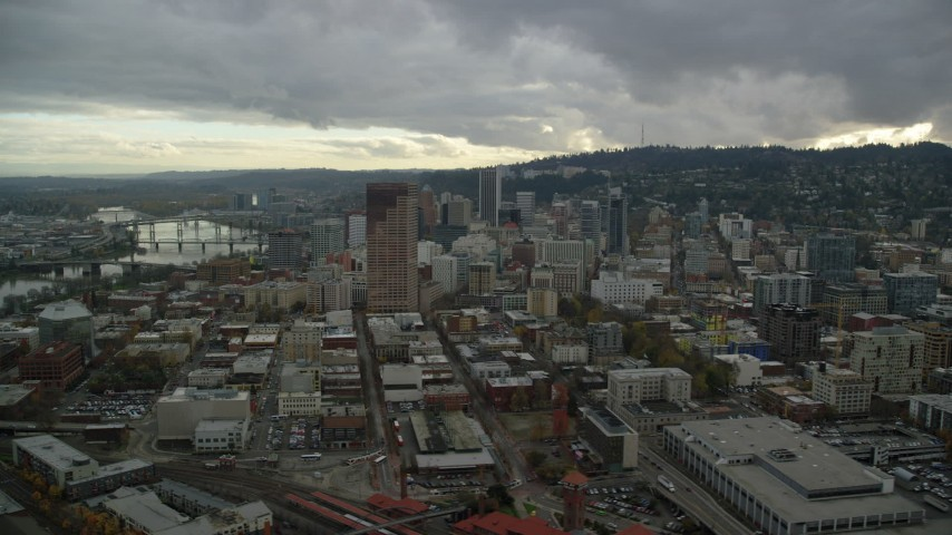 6K stock footage aerial video flying by skyscrapers, downtown buildings, and US Bancorp Tower near the Willamette River in Downtown Portland, Oregon Aerial Stock Footage | AX155_054