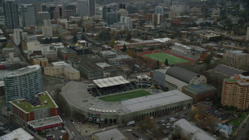 6K stock footage aerial video tilting to and flyby Providence Park in Goose Hollow, Portland, Oregon Aerial Stock Footage AX155_057 | Axiom Images