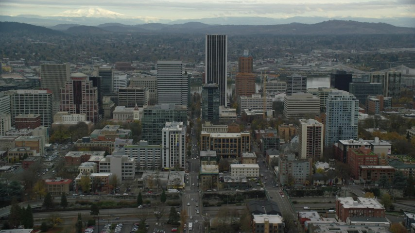 6K stock footage aerial video of skyscrapers and downtown buildings by Wells Fargo Center in Downtown Portland, Oregon Aerial Stock Footage | AX155_058