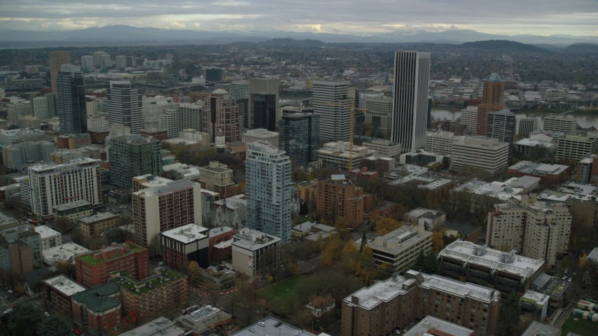 Flyby downtown high-rises near Wells Fargo Center and South Park Blocks in Downtown Portland, Oregon Aerial Stock Footage | AX155_059