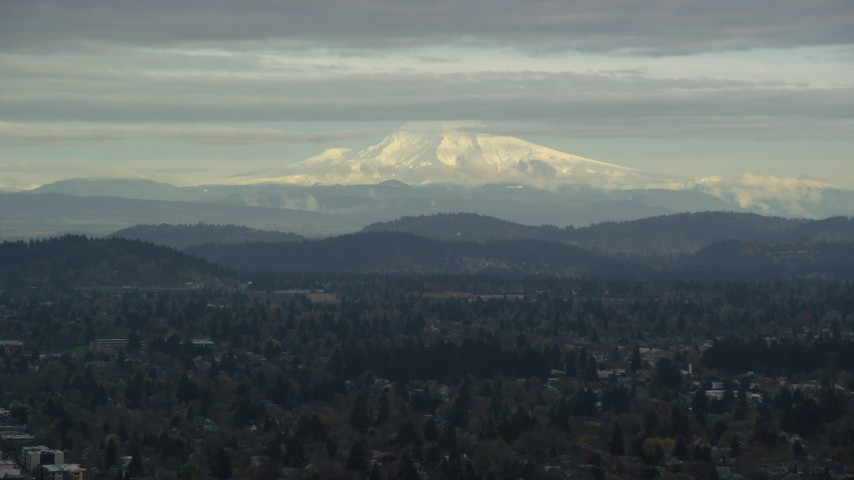 6K stock footage aerial video of snowy Mount Hood seen from suburban residential neighborhoods in Portland, Oregon Aerial Stock Footage | AX155_062