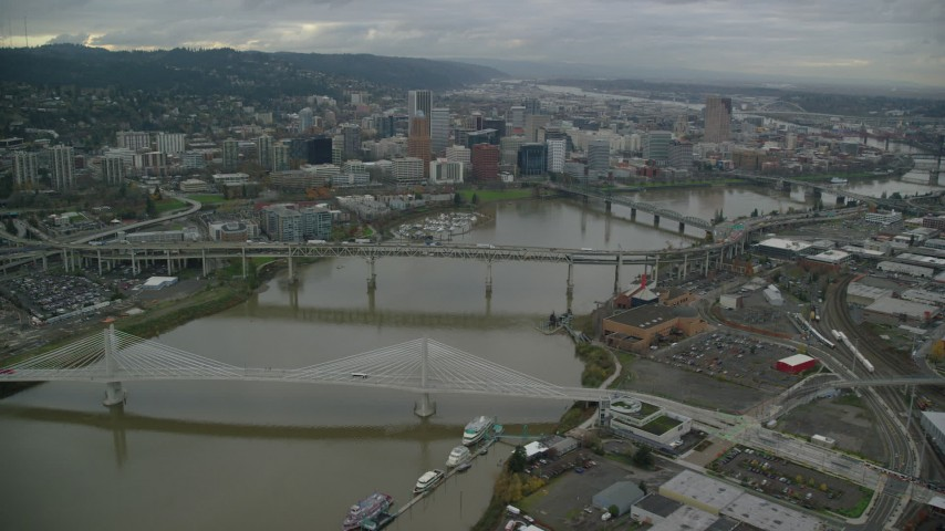 6K stock footage aerial video flying over bridges to approach Downtown Portland, Oregon Aerial Stock Footage | AX155_063