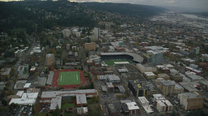 6K stock footage aerial video approaching Providence Park beside Lincoln High School's football field Portland, Oregon Aerial Stock Footage | AX155_065