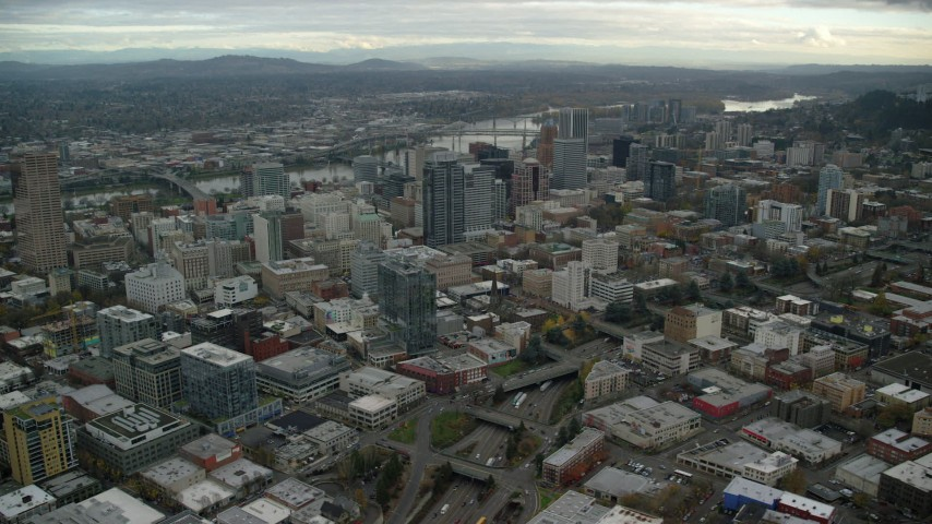 6K aerial video of Downtown Portland, Oregon cityscape and the I-405 freeway Aerial Stock Footage AX155_067