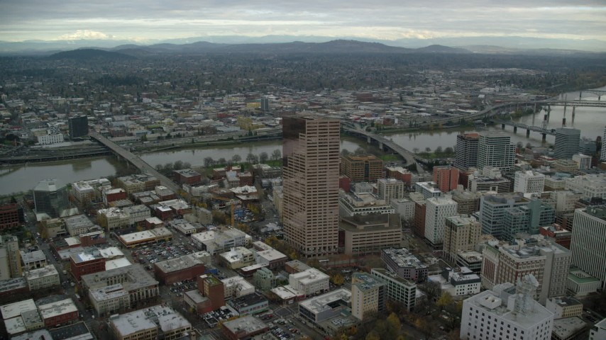 6K stock footage aerial video approaching US Bancorp Tower and tilt down in Downtown Portland, Oregon Aerial Stock Footage | AX155_068