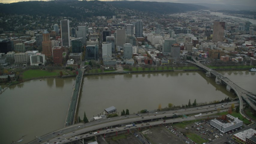 6K stock footage aerial video following Hawthorne Bridge toward riverfront park and skyscrapers in Downtown Portland, Oregon Aerial Stock Footage | AX155_070